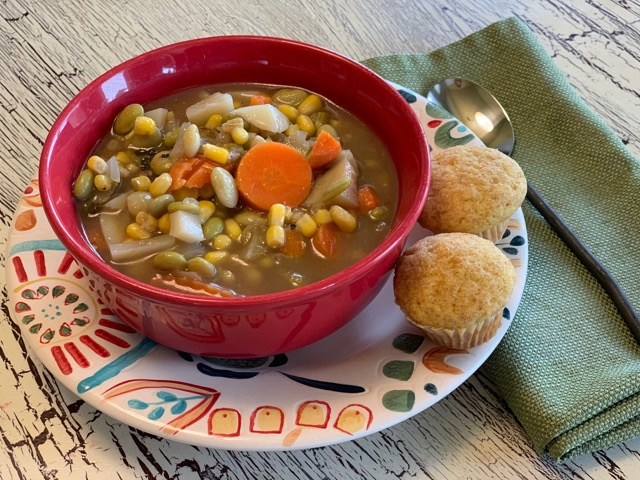 bowl of vegetable soup with cornbread